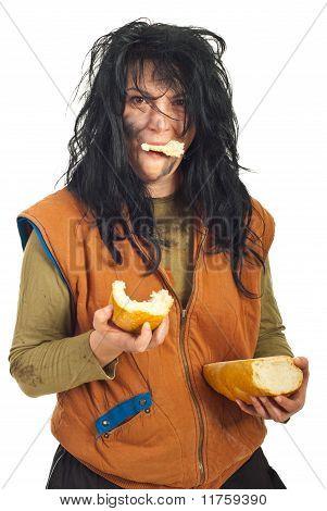 Happy Beggar Woman Eating  Bread