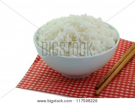 steamed rice in the bowl with chopsticks