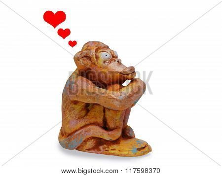 sad monkey from clay pottery  dreams about love. love concept.  isolated on white