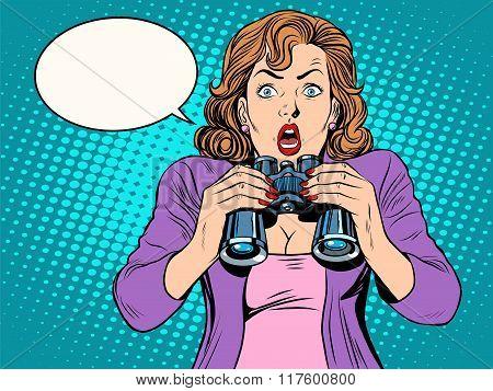 Surprised girl with binoculars