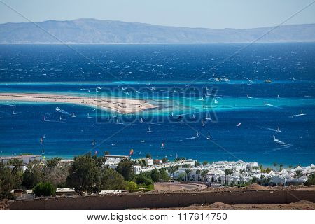 Lagoon full of windsurfers in the town of Dahab, Egypt