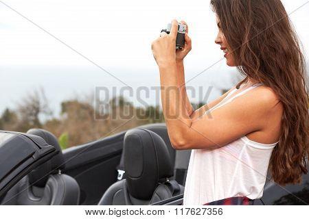 Woman tourist taking photo