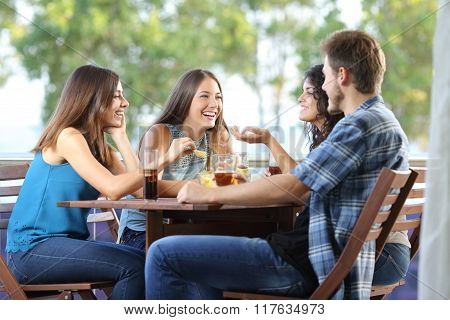 Group Of Friends Talking And Drinking At Home