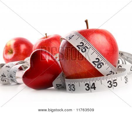 Red Apples,heart And Measuring Tape On White