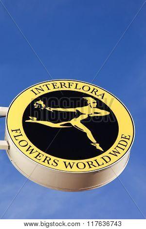 Interflora logo against a wall
