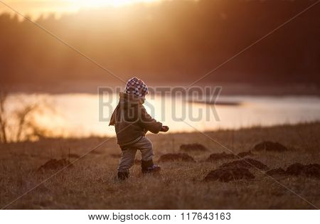 Little Boy Playing Outdoor Near Lake