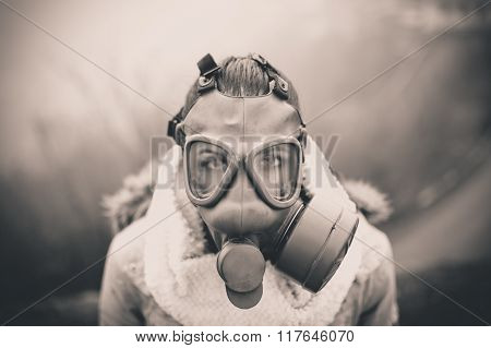 Environmental disaster.Woman breathing trough gas mask,health in danger.Concept of pollution