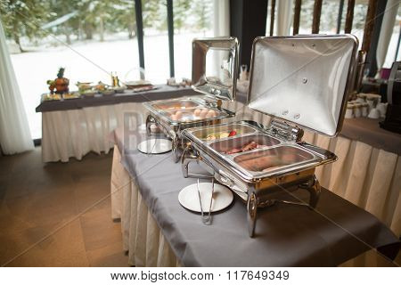 Buffet heated trays ready for service.Breakfast at the hotel. Breakfast Buffet.catering food wedding
