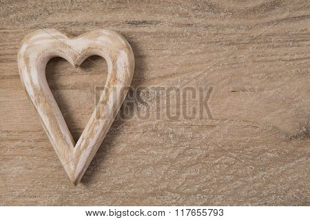 Wooden hart on wood