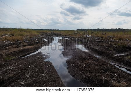 The road along with puddles in Russia in 2015