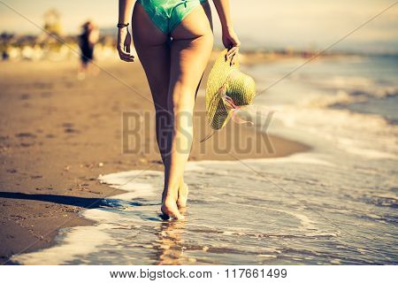 Summer beach woman enjoying summer and sun.Freedom, happiness.Fit and healthy summer body.Footsteps