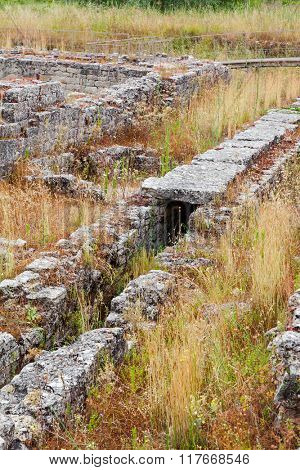 Detail of the roman sewer system near the Insulae zone of Conimbriga. Conimbriga, in Portugal, is one of the best preserved Roman cities on the west of the empire. poster