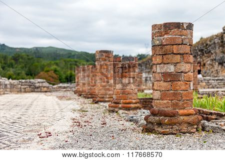Columns of the Peristyle structure built around the inner pond and garden of the House of the Swastika. Conimbriga in Portugal, is one of the best preserved Roman cities on the west of the empire.