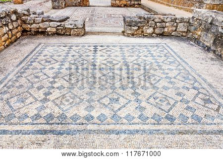 Room decorated with monochrome Roman mosaic pavement made with tesseras, in the House of the Swastika. Conimbriga in Portugal, is one of the best preserved Roman cities on the west of the empire.