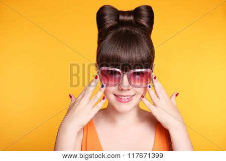 Happy Smiling Teen Girl With Fashion Sunglasses, Bow Hairstyle And Colourful Manicured Polish Nails.