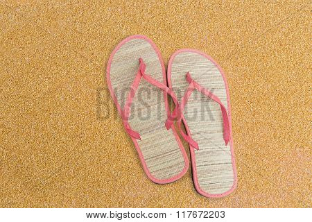 Pink flip flips on sand for background poster