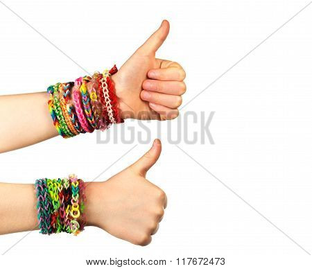 Two hand with trendy handmade weaving bracelets show okey