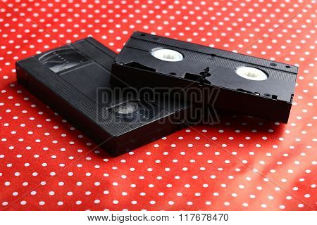 Videocassette On The Red Background