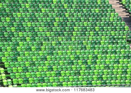 Green Colored Seats In Row In A Soccer Stadium