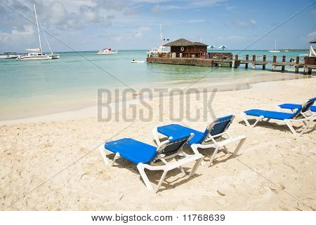 Blue Lounge Chairs on the Beach