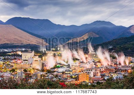 Beppu, Japan cityscape with hot spring bath houses with rising steam.