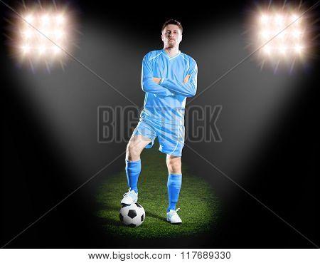 football player in blue uniform. on grass field