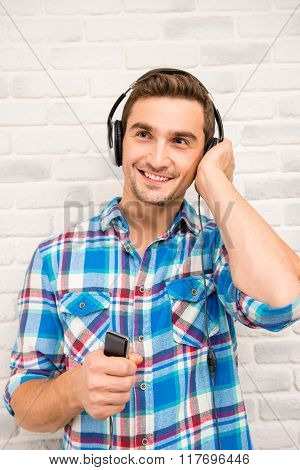 Handsome Student Listens To Music In His Ipod