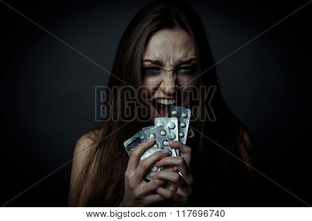 Young Depressed Woman Ussing Pills Or Drugs