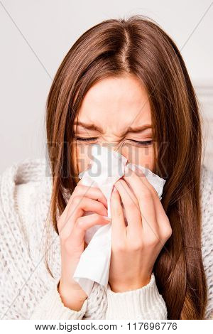 Close Up Portrait Of Sick Woman  With Fever Sneezing In Tissue