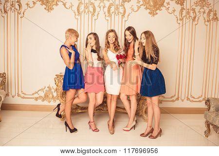 Portrait Of Nice Surprised Girls Looking At Bride's Wedding Ring