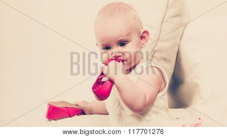 Baby Girl Biting Shoe