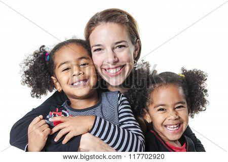 family posing on a white background studio