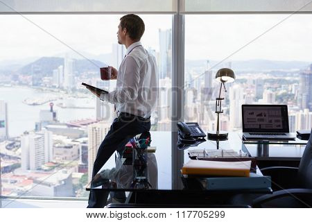 Business Man Reading News Press Review On Tablet Pc
