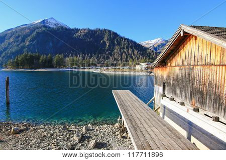 A pier for boat trips on Achensee Lake during winter in Tirol, Austria. The Achensee is the largest lake within the federal state, and has a maximal depth of 133 meters