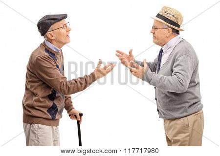 Studio shot of two senior gentlemen arguing with each other isolated on white background