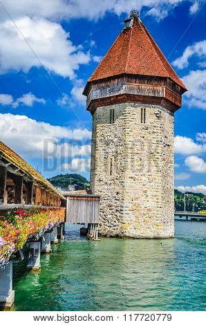 Luzern Switzerland. View of the famous wooden Chapel Bridge of Luzern Lucerne in Swiss Confederation with the tower in foreground