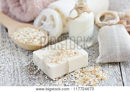 Handmade soap with oatmeal and milk on a wooden table poster
