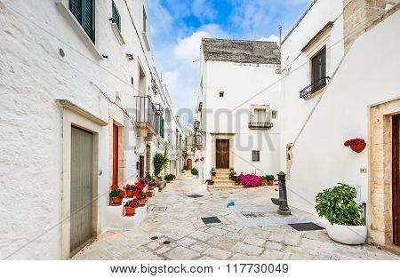 Locorotondo Italy. Medieval whitewashed street and houses in small city of Puglia Apulia Bari region.