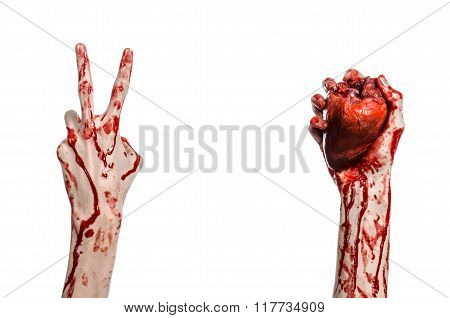 Blood And Halloween Theme: Terrible Bloody Hand Hold Torn Bleeding Human Heart Isolated On White