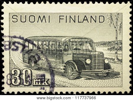 Old Postal Bus Rides On Rural Road