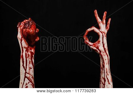 Blood And Halloween Theme: Terrible Bloody Hand Hold Torn Bleeding Human Heart Isolated On Black Bac