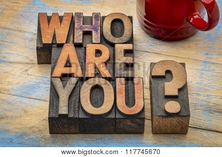 Who are you question in vintage letterpress wood type printing blocks with a cup of coffee