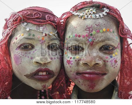 Allahabad, India- february 12: Portrait of Indian kids wearing exotic costume for the Kumbh Mela festival in Allahabad, Uttar Pradesh, India.Kumbh Mela is the largest religious festival in the world. It is usually held every four year in India.