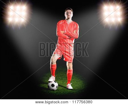 football player in red uniform. on grass field