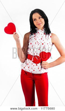 Young Beautiful Brunette Girl  Hugs A Big Soft Heart. Feast Of St. Valentine's Day.
