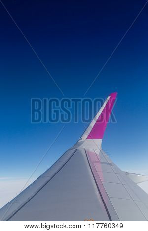 Airplane wing against clear blue sky,  aerial shot