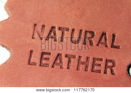 Naturel leather label of brown colour with text