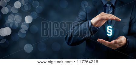 Lawyer (advocate jurist) help protect rights. Law represented by paragraph symbol. Protection of rights and freedoms. Wide banner composition and bokeh in background. poster