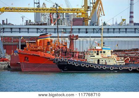 Bunker Ship And Tugboat Under Port Crane