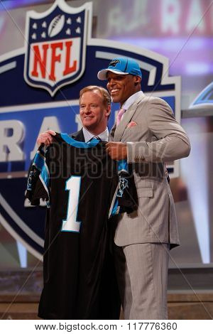 Cam Newton (R) is introduced by Commissioner of the National Football League Roger Goodell as the first pick to the Carolina Panthers at the NFL Draft 2011 at Radio City Music Hall in New York, NY.